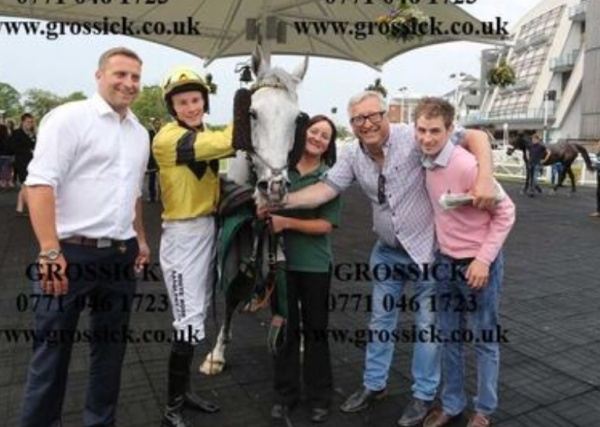 Happy team at Aintree with King's grey