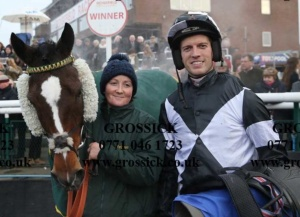 Julie and Adam in the winners enclosure with Istimrar on Boxing day