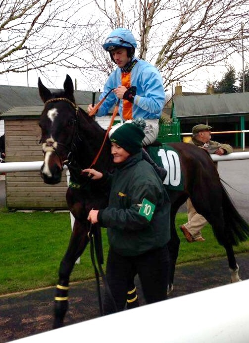 Keep Up going down to the start in Colin Fletchers' lucky orange and blue silks.