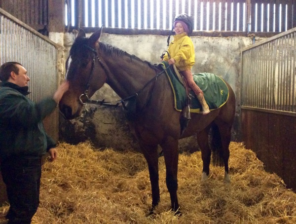 Indy Kirby having a sit on our tallest horse, Transient Bay