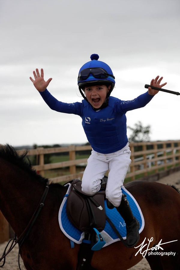 Lilly and her flying winners dismount