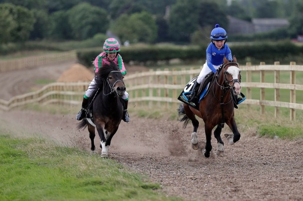 Winner of the 'Green Oaks Gold Cup' Lilly Aspell leads Izzy Kirby , Lilly taking after her jockey father, Paddy Aspell
