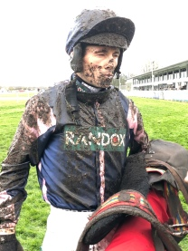 Sean covered in mud after the last