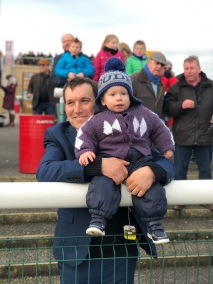 Simon with Jack watching her in the paddock